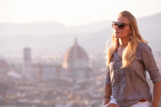 Traveler woman on cityscape background, Florence cityscape and  cathedral Saint Mary of the Flower, Basilica di Santa Maria del Fiore in Tuscany Florence