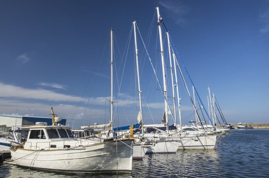 White sailing boats anchored in the  harbor.
