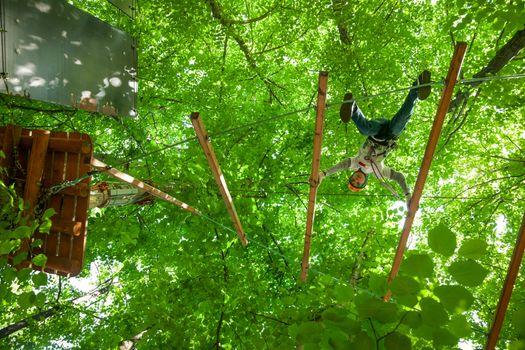 Kid in a treetop adventure park