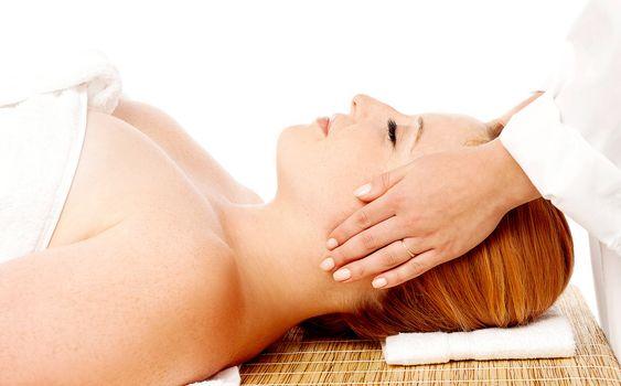 Young woman enjoying facial massage