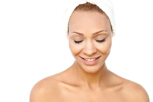 Happy woman after bath with closed eyes