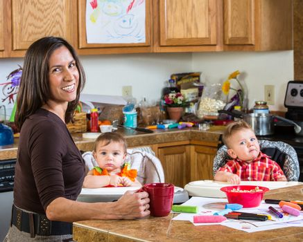 Smiling mother poses with her babies