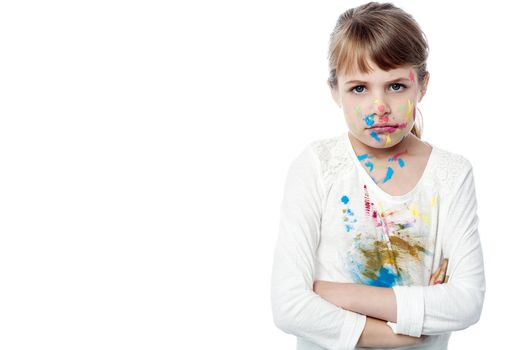Serious girl with paint on face