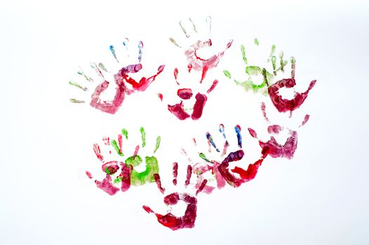 Multicoloured painted hand prints isolated on white