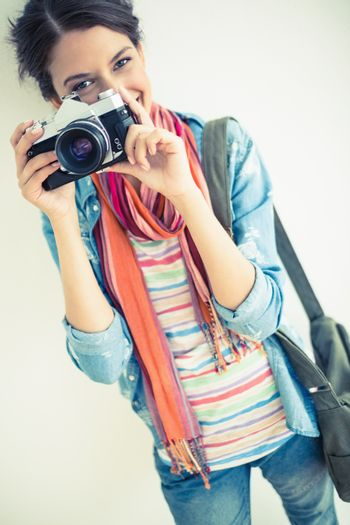 Attractive brunette taking a photograph