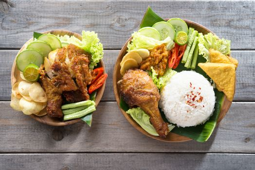 Famous traditional Indonesian food. Delicious nasi ayam penyet with sambal belacan. Fried chicken rice.