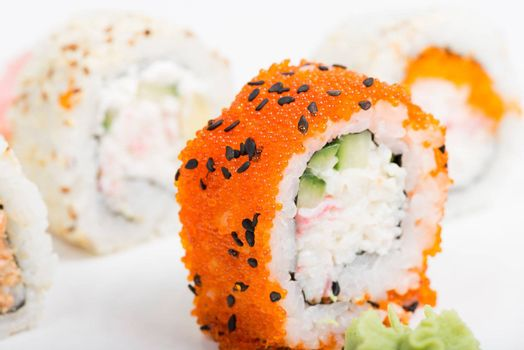 Macro shot of sushi with tobiko on the plate