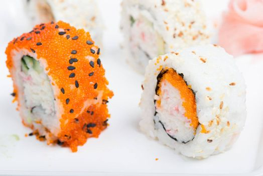 Orange and white shushi rolls. Shallow depth of field. Focus on the white rise