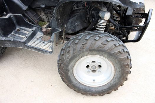 Car Wheel of ATV on stop.