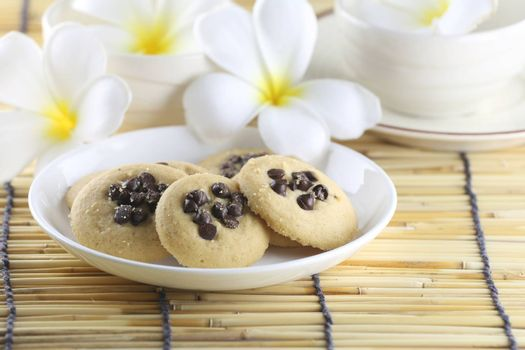 chocolate chip cookies in the white dish.