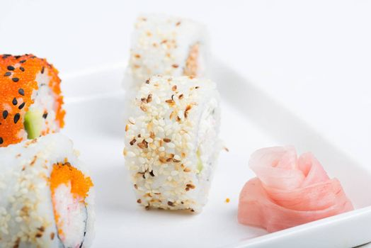 Sushi set with ginger rose on the plate