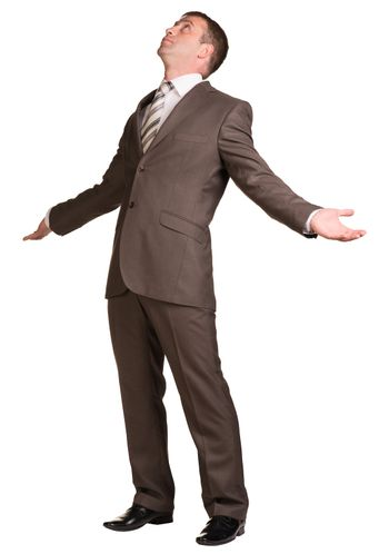 Businessman holding hands up to sides
