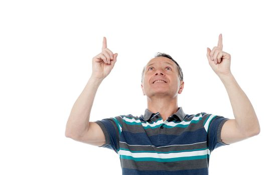 Caucasian man pointing up his fingers