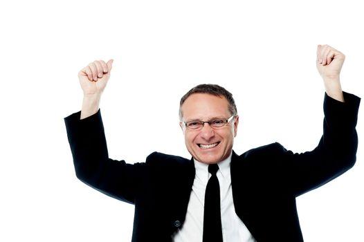 Successful businessman raising his arms