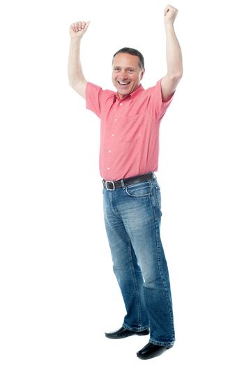Mature gentleman with raised arms