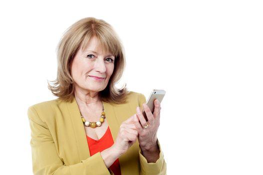 Aged woman using smart phone