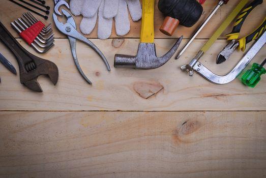 tool renovation on  wood plank table