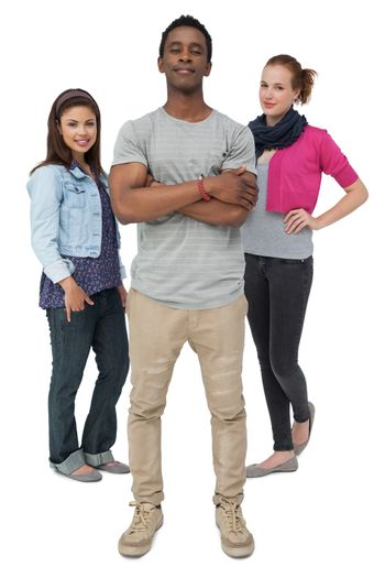 Full length portrait of three happy young people