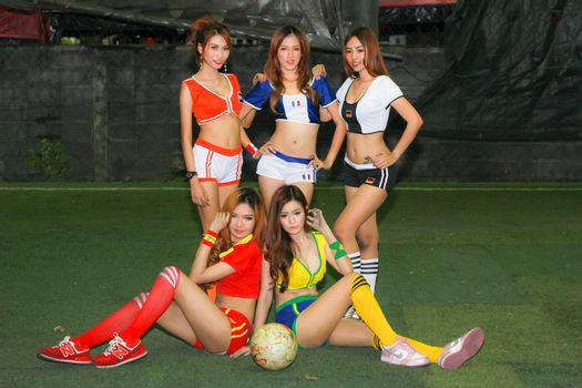 BANGKOK, THAILAND - JUNE 29, 2014: Unidentified model with Football costume pose for promote World Cup 2014 in futsal park on June 29, 2014 in Bangkok, Thailand.