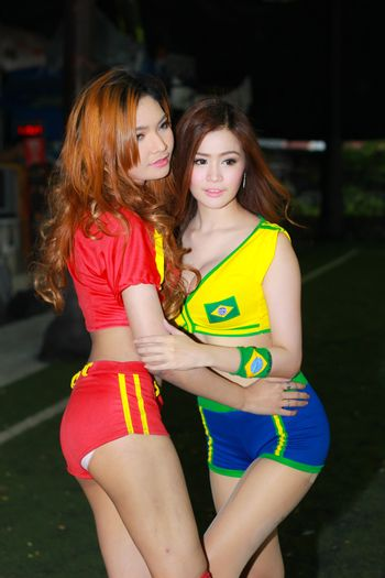 BANGKOK, THAILAND - JUNE 29, 2014: Unidentified model with Spain and Brazil costume pose for promote World Cup 2014 in futsal park on June 29, 2014 in Bangkok, Thailand.
