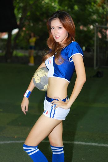 BANGKOK, THAILAND - JUNE 29, 2014: Unidentified model with Italy costume pose for promote World Cup 2014 in futsal park on June 29, 2014 in Bangkok, Thailand.