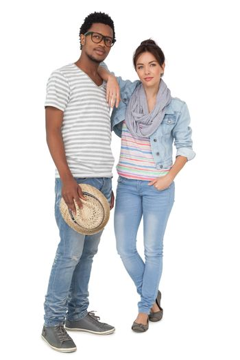 Full length portrait of a cool young couple