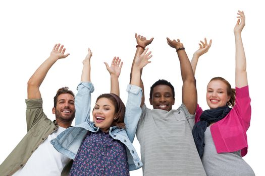 Portrait of four young friends raising hands