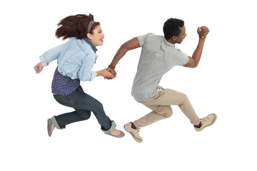 Side view of a cheerful couple jumping