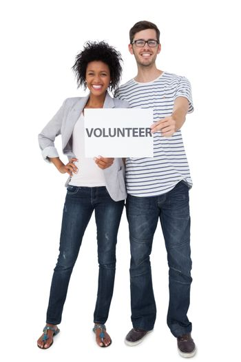 Portrait of a happy couple holding a volunteer note