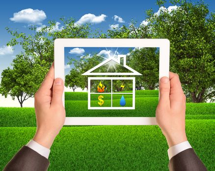 Hands hold tablet pc with symbols of public service and house. Landscape as backdrop