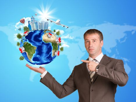 Businessman in a suit hold Earth with buildings. Elements of this image are furnished by NASA