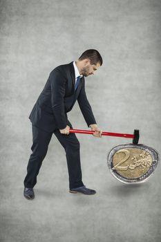 Businessman destroys euro
