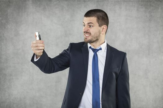 angry businessman with a phone in his hand