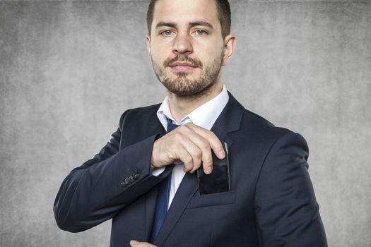 businessman hiding a phone