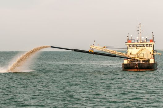 Barge Pipe pushing sand onto the beach