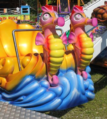 Close up shot of the seahorse in a merry-go-round theme park.