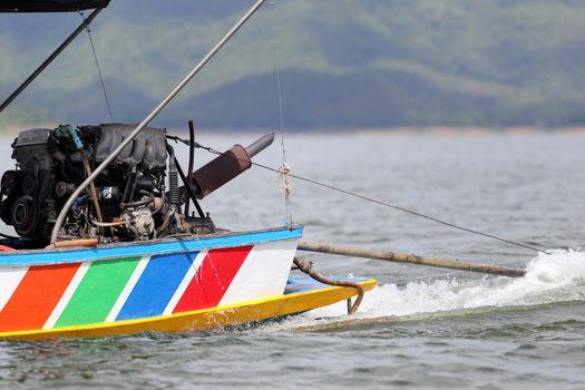 Outboard motor running.