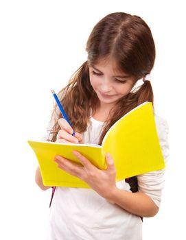 School girl writing in notebook