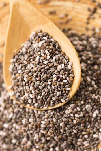 Nutritious chia seeds on a wooden spoon