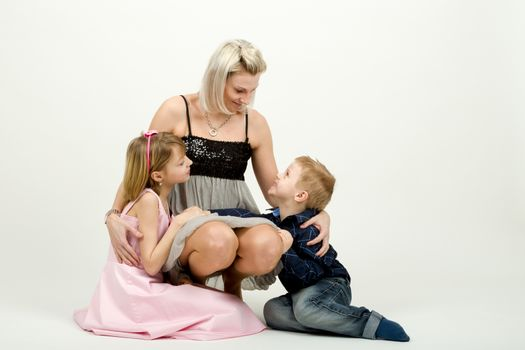 Studio portrait of siblings beautiful boy and girl and mother