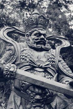 Aged asian god statue