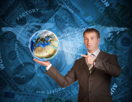 Business man hold Earth in hand. World map and money on background. Elements of this image are furnished by NASA