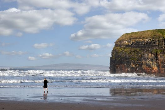 woman in high heels at cliffs of Ballybunion on the wild atlantic way in county Kerry Ireland