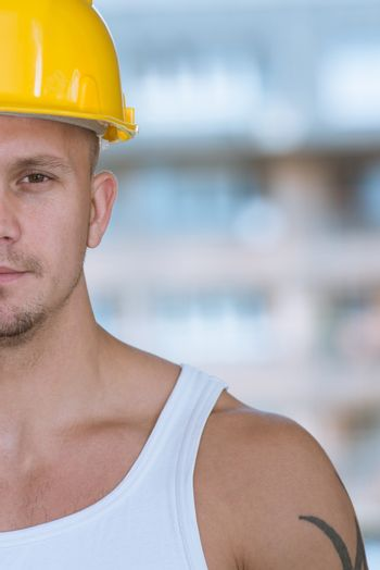 Portrait Half Of Face Of Young Worker