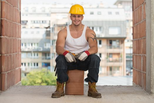 Worker Is Resting Sitting On Brick