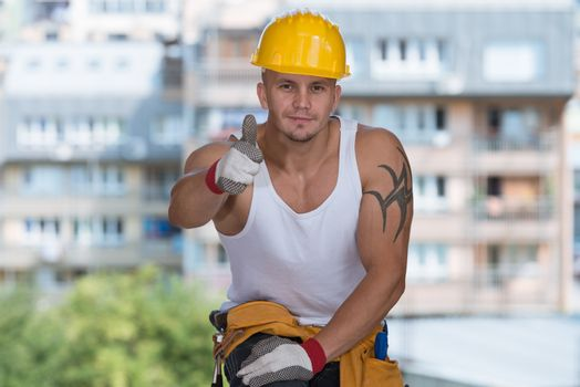 Happy Caucasian Construction Worker Giving Thumb Up