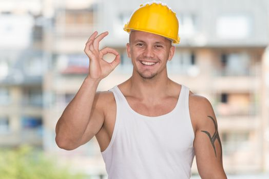 Worker With Protective Gear Showing Ok Sign