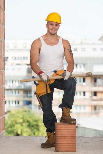 Portrait Of Handsome Engineer With Pickaxe