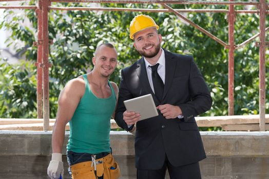 Portrait Of Builder And Businessman Working At Construction