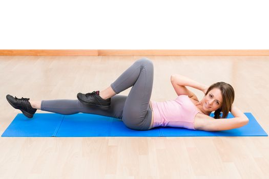 Young healthy woman fitness abdominal exercises